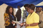 The First Lady Esther Lungu, FAWE Chairperson-Prof. Dranzoa and Minister of General Education Dr. Wanchinga and Nampaka Nkumbula presenting GN during the Exhibition