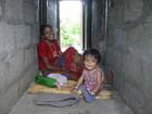 nepal finance woman and child.jpg