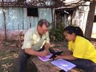 A surveyor working with a study participant.