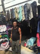 A used clothing trader and his stock in Lagos, Nigeria