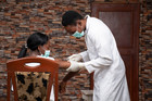 A patient receives a dose of the COVID-19 vaccine in Nigeria
