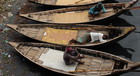 Workers resting on boats in Bangladesh