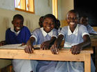 School girls sit in a classroom in Kenya