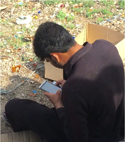 A man in Pakistan uses a smartphone