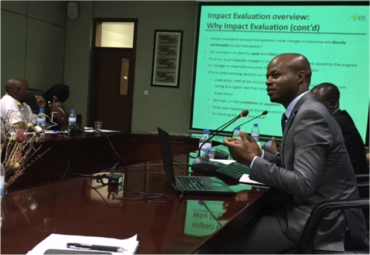 Emmanuel Hakizimfura, Senior Research Associate for the Financial Education evaluation in Rwanda, presenting during the workshop.
