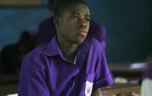 A Ghanaian student sits in class