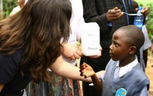 A child is given deworming medicine in Kenya