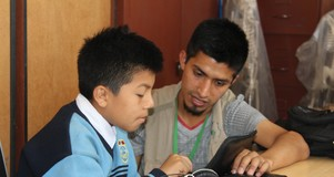 A student uses the tablet program.