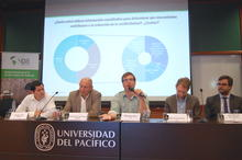 Speakers presenting evidence from studies on conflict resolution in Peru