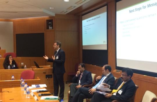 Aaron Dibner-Dunlap speaks at the Evidence in Financial Inclusion event