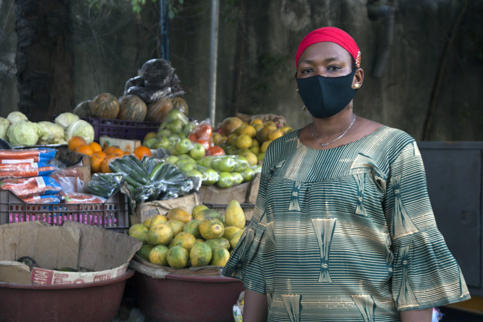 Vendor wearing mask in C'ote D'Ivoire